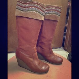 Brown leather boots with stitching on top